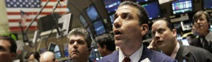 Trader Vincent Vincent Quinones, foreground right, gathers with other traders on the floor of the New York Stock Exchange, Tuesday March 18, 2008.  Wall Street gave up some of its steep gains Tuesday while investors digested the Federal Reserve's decision to cut interest rates by three-quarters of a percentage point. Many investors had expected a cut of a full percentage point. (AP Photo/Richard Drew)